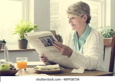 Senior Adult Reading Newspaper Leisure Concept