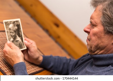 senior adult watching a photo from his childhood