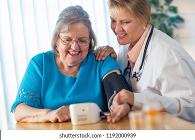 Senior Adult Woman Learning From Female Doctor to Use Blood Pressure Machine.