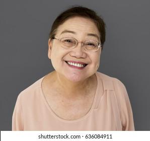 Senior adult woman smiling casual studio portrait