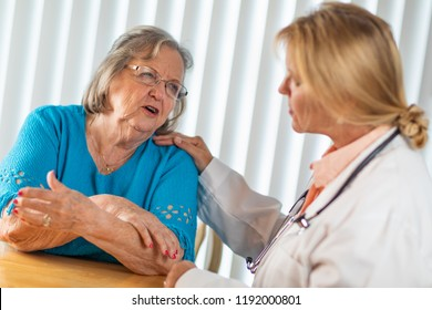 Senior Adult Woman Talking with Female Doctor About Sore Arm.