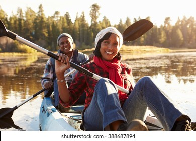 Senior African American Couple Rowing Kayak On Lake
