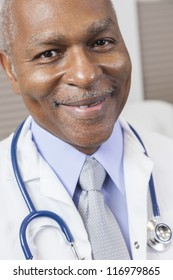 A senior African American male doctor wearing a shirt, tie, white coat and stethoscope