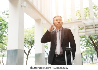 senior asian business man on a phone