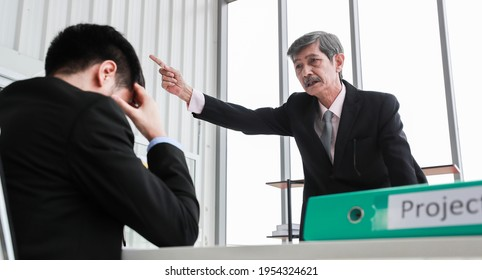 Senior Asian businessman with mustache leader standing, shouting and firing unprofessional male office workers out of company from poor performance and bad working. Concept of unemployment