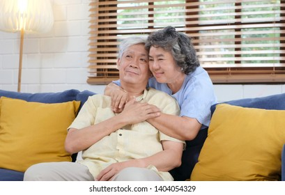 Senior asian couple in happy moment at home living room background, people emotional