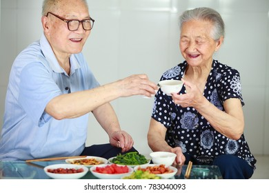 senior asian couple having meal indoor