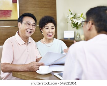 senior asian couple listen to explanation by a sales representative, happy and smiling.