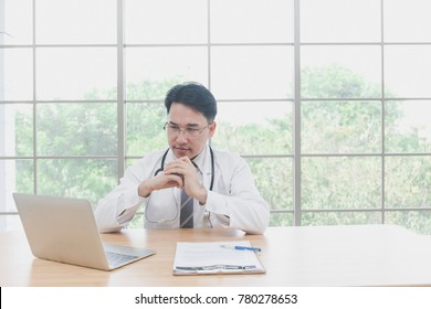 Senior Asian doctor or Teacher or expert making video call or live video on social network with patient or student while sitting on modern office or hospital. Concept of Education or technology,health