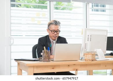 senior asian male at work