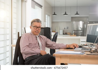 senior asian male at work