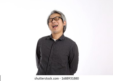 The senior Asian man on the white background.