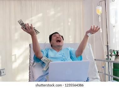 Senior Asian Man patient work hard and money falling on the bed in hospital ,insurance concept