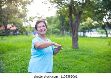 Senior Asian woman have happiness and have wellbeing life by exercise with freshness in the park, maintaining the health of an elderly woman in retirement concept.