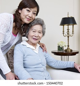 senior asian woman and her adult daughter.