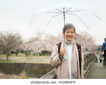 Senior Asian woman with umbrella in Nishikyo-ku, Kyoto, Japan
