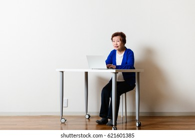 Senior asian women using a PC