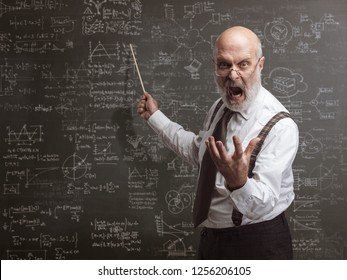 Senior authoritarian professor yelling and pointing at the blackboard with a stick: traditional education concept