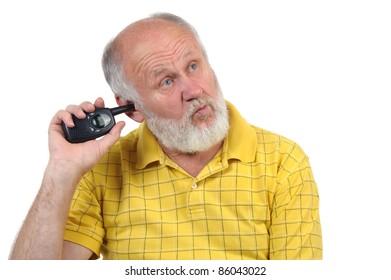 senior bald man picking his ear with walkie-talkie antenna