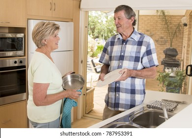 senior beautiful middle age couple around 70 years old smiling happy at home kitchen washing the dishes looking sweet together in lifetime husband and wife enjoying life and love concept