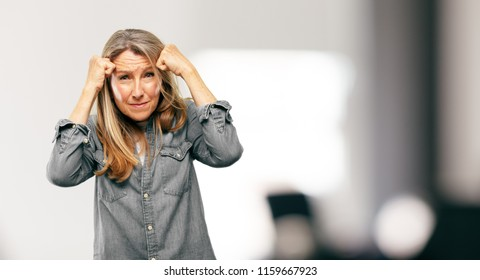 senior beautiful woman looking stressed and frustrated, expressing dismay and disbelief.
