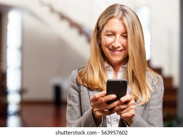 senior beautiful woman with mobile phone