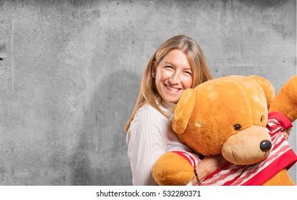senior beautiful woman with a teddy bear