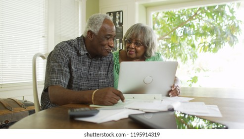 Senior black couple on the laptop computer
