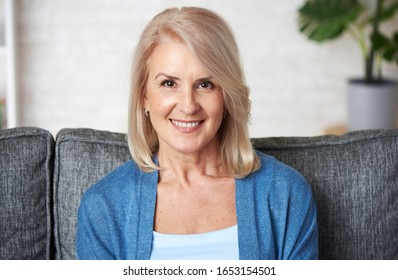 Senior blonde lady. Beautiful old woman is smiling toothy