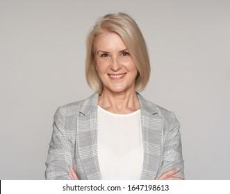 Senior blonde woman isolated on white background