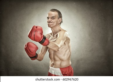 senior boxer man with red gloves old portrait on textured background