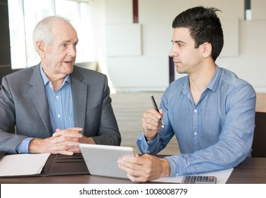 Senior Business Expert Consulting Young Employee