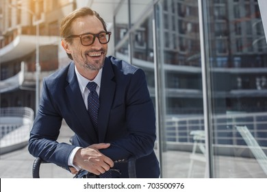 Senior business man with a bicycle outdoors
