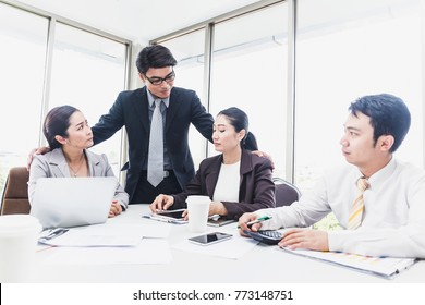 Senior business man or Manager touching the arm or shoulders of business woman or secretary or Colleague while meeting or discussion on workplace at modern office. Sexual harassment concept