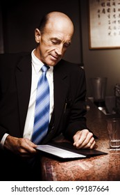 Senior Business Man Placing Order At The Counter Of A Asian Restaurant In A Chinese Dining And Takeaway Conceptual