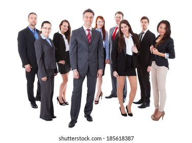 Senior business manager standing on front of his team. Isolated on white