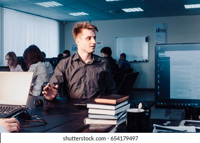 Senior business mans talking with young worker in office. Business people with computer sitting at office and consulting. The employee reports to the management. stressful situation close