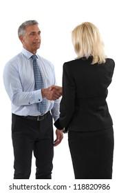 Senior business partners shaking hands