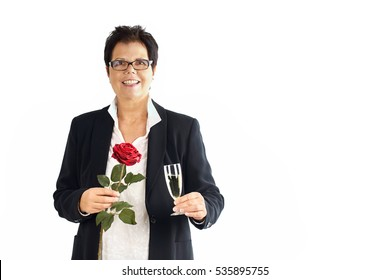 Senior Business woman holding a glass of champagne and a rose
