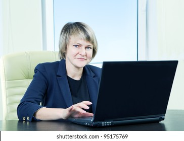 senior business woman in office interior with notebook
