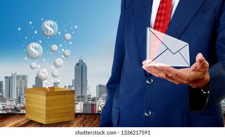 Senior businessman carry email with money bubbles icon float from wooden box beside, Bubble economy  concept