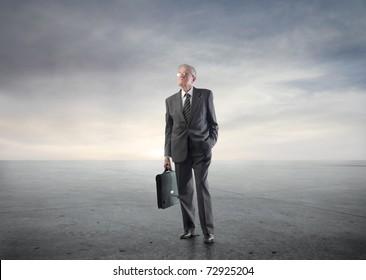 Senior businessman carrying a briefcase