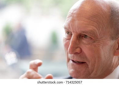 Senior businessman, CEO, director portrait. Candid unposed shot