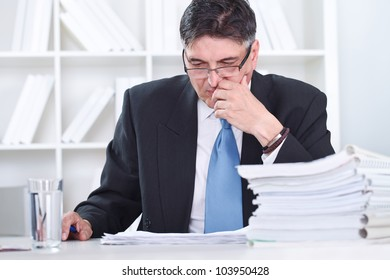 Senior businessman concentrate on work in office