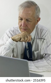 Senior businessman at desk