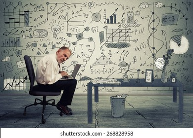 Senior businessman executive working on laptop in office. Corporate investment consultant analyzing company annual financial report balance sheet statement documents graphs. Economy concept