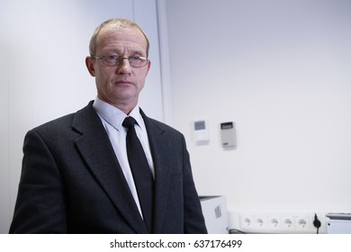 Senior businessman with glasses in the office