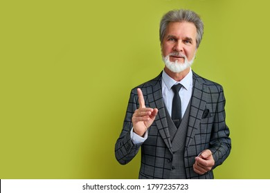 senior businessman has a good idea, point finger up, look at camera