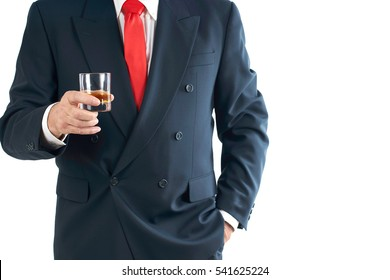 Senior Businessman holding a glass of Whisky, isolated