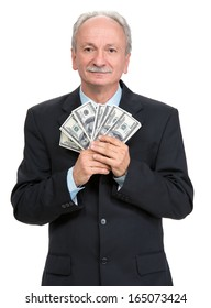 Senior businessman holding group of dollar bills on a white background